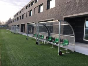 Freestanding team shelter aluminium construction, portable on wheels, seats on 2 rows, transparent polycarbonate panels.